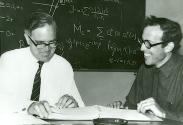 Aage Bohr and Ben Mottelson studying some papers